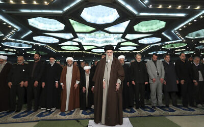 In this photo released by the official website of the office of the Iranian supreme leader, Supreme Leader Ayatollah Ali Khamenei, center, leads the Friday prayers at Imam Khomeini Grand Mosque in Tehran, Iran, Friday, Jan. 17, 2020.  (Office of the Iranian Supreme Leader via AP)
