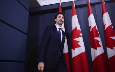 Canada Prime Minister Justin Trudeau arrives at a press conference at the National Press Theatre in Ottawa, January 17, 2020. (Sean Kilpatrick/The Canadian Press via AP)