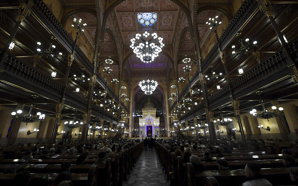 Illustrative: People attend a ceremony that commemorates the 75th anniversary of the liberation of the Budapest Jewish ghetto in Dohany Street Synagogue in Budapest, Hungary on January 19, 2020. (Tibor Illyes/MTI via AP)