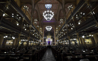 People attend a ceremony that commemorates the 75th anniversary of the liberation of the Budapest Jewish ghetto in Dohany Street Synagogue in Budapest, Hungary on January 19, 2020. (Tibor Illyes/MTI via AP)