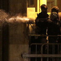 Riot police fire rubber bullets against anti-government protesters, during ongoing protests against the political elites who have ruled the country for decades, in Beirut, Lebanon, January 19, 2020. (AP Photo/Hassan Ammar)