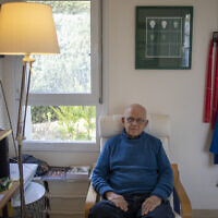 Holocaust survivor Maurice Gluck, poses for a photo in his home in Ya'ad, northern Israel, January 17, 2020. (Ariel Schalit/AP)