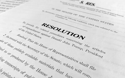 A copy of a Senate draft resolution to be offered by Senate Majority Leader Mitch McConnell, Republican-Kentucky, regarding the procedures during the impeachment trial of US President Donald Trump in Washington, January. 20, 2020. (Jon Elswick/AP)