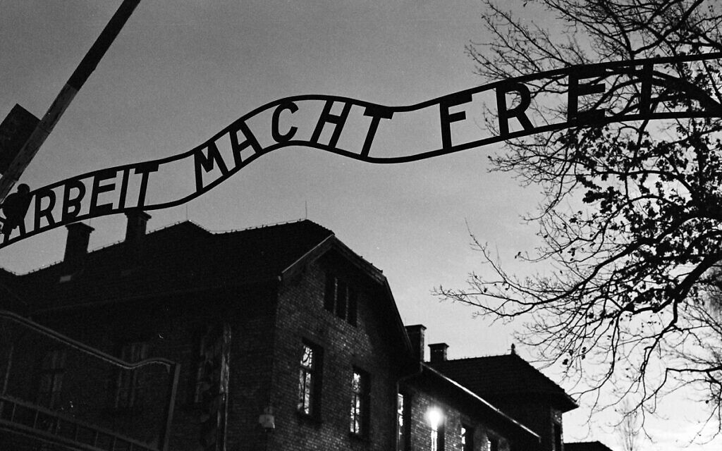 The main entrance at the former Nazi death camp of Auschwitz in Oswiecim, Poland, with the inscription, 'Arbeit Macht Frei', which translates into English as 'Work will set you Free,' December 8, 2019. (Markus Schreiber/AP)