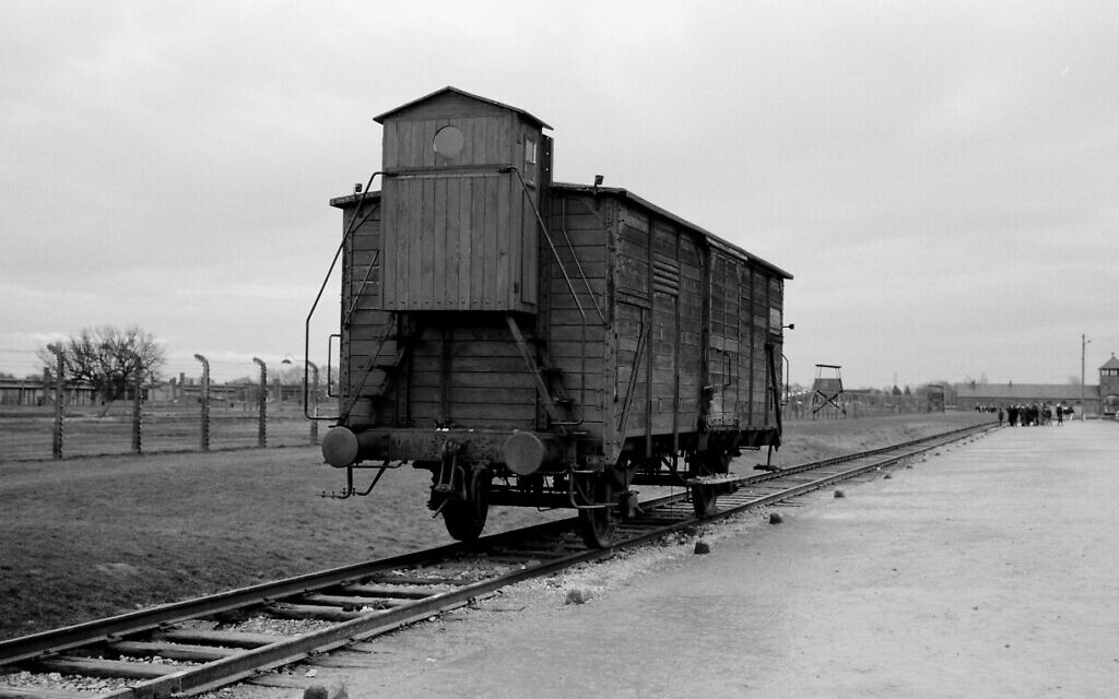 A wagon stands on the railway tracks from where hundreds of thousands of people were directed to the gas chambers to be murdered inside the former Nazi death camp of Auschwitz-Birkenau or Auschwitz II, in Oswiecim, Poland, December 8, 2019. (Markus Schreiber/AP)
