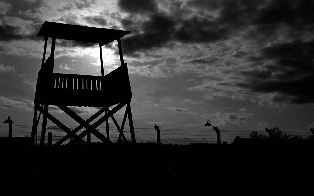 An observation tower stands inside the former Nazi death camp of Auschwitz Birkenau or Auschwitz II in Oswiecim, Poland, December 8, 2019. (Markus Schreiber/AP)