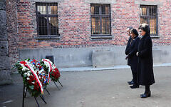 In this image provided by the US Consulate General in Krakow, US House Speaker Nancy Pelosi, center, and speakers of Poland's parliament lay wreaths at the executions Death Wall of the World War II Nazi death camp of Auschwitz-Birkenau during a visit to the site of the former camp just days before the 75th anniversary of its 1945 liberation by the Soviet troops, at the Auschwitz-Birkenau Museum, in southern Poland, on Tuesday, Jan. 21, 2020. (US Consulate General in Krakow via AP)