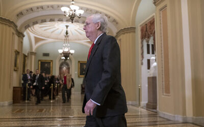 US Senate Majority Leader Mitch McConnell arrives at the Senate for the start of the impeachment trial of US President Donald Trump on charges of abuse of power and obstruction of Congress, at the Capitol in Washington, January 21, 2020. (AP Photo/J. Scott Applewhite)