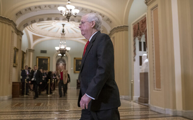 Senate Majority Leader Mitch McConnell, R-Kentucky, arrives at the Senate for the start of the impeachment trial of US President Donald Trump on charges of abuse of power and obstruction of Congress, at the Capitol in Washington, January 21, 2020. (AP Photo/J. Scott Applewhite)