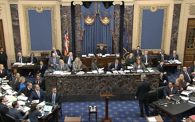 In this image from video, White House counsel Pat Cipollone waits in the US Senate chamber to be recognized by the presiding officer, Supreme Court Chief Justice John Roberts, during the impeachment trial against President Donald Trump in the Senate at the US Capitol in Washington, January 21, 2020. (Senate Television via AP)