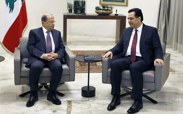 Lebanese President Michel Aoun, left, meets with Prime Minister-Designate Hassan Diab at the Presidential Palace in Baabda, east of Beirut, Lebanon, January 21, 2020. (AP Photo/Bilal Hussein)