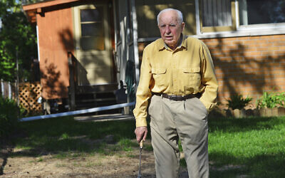 In this May 2014 file photo, Michael Karkoc works in his yard in Minneapolis. Karkoc, a retired Minnesota carpenter whom The Associated Press exposed as a former commander of a Nazi-led unit accused of war atrocities, died December 14, 2019, according to cemetery and public records. (Richard Sennott/Star Tribune via AP)