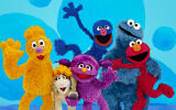 From left, Jad, Ma'zooza, Basma, grover, background center, Cookie Monster and Elmo, characters in a new, locally produced Arabic TV program 'Welcome Sesame' for the hundreds of thousands of children dealing with displacement in Syria, Iraq, Jordan and Lebanon. (Sesame Workshop via AP)