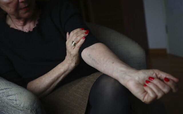 Eva Umlauf shows her tattooed number in Munich, Germany, January 8, 2020. (Matthias Schrader/AP)