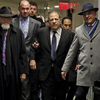 Harvey Weinstein, center, accompanied by attorney Arthur Aidala, right, arrives at court for his rape trial, in New York  on January 22, 2020. (AP/Richard Drew)