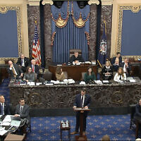 In this image from video, House impeachment manager Rep. Jason Crow, Democrat-Colorado, pauses as he speaks during the impeachment trial against US President Donald Trump in the Senate at the US Capitol in Washington, January 22, 2020. (Senate Television via AP)
