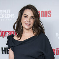 "In this January 9, 2019, file photo, Annabella Sciorra attends HBO's ""The Sopranos"" 20th anniversary at the SVA Theatre in New York. (Charles Sykes/Invision/AP, File)"
