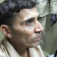 This undated image provided by the FBI in a US District Court filing in Washington on Feb. 29, 2019, shows Mustafa al-Imam after his capture in October 2017. A federal judge has sentenced Mustafa al-Imam to 19 years in federal prison for helping to plan the 2012 attacks in Benghazi. (FBI via AP)