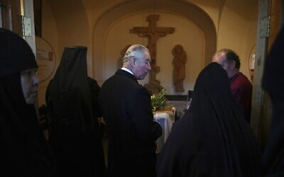 Britain's Prince Charles, center,  visits the tomb where his grandmother Princess Alice is buried at the Church of St Mary Magdalene at the Mount of Olives in Jerusalem, Israel, Friday, Jan. 2020. (Neil Hall/Pool Photo via AP)