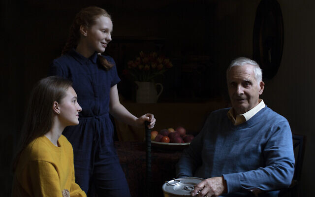In this photo taken by Britain's Kate, Duchess of Cambridge, and made available on January 26, 2020, Steven Frank BEM, aged 84, originally from Amsterdam, who survived multiple concentration camps as a child, is pictured alongside his granddaughters Maggie and Trixie Fleet, aged 15 and 13. (The Duchess of Cambridge via AP)