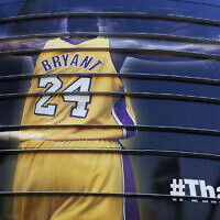 In this April 13, 2016 file photo a giant banner congratulating Kobe Bryant is draped around Staples Center before his last NBA basketball game, a contest against the Utah Jazz, in downtown Los Angeles. Bryant, a five-time NBA champion and a two-time Olympic gold medalist, died in a helicopter crash in California on Sunday, Jan. 26, 2020. He was 41. (AP Photo/Richard Vogel, file)