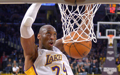 In this January 4, 2015 file photo Los Angeles Lakers guard Kobe Bryant dunks during the first half of an NBA basketball game against the Indiana Pacers in Los Angeles. (AP Photo/Mark J. Terrill)