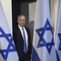 In this November 20, 2019, file photo, Blue and White party leader Benny Gantz arrives to address media in Tel Aviv. (AP Photo/Oded Balilty, File)