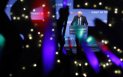 In this November 17, 2019 file photo, Democratic presidential candidate Sen. Bernie Sanders, I-Vt., speaks as supporters wave lighted signs during a fundraiser for the Nevada Democratic Party in Las Vegas.(AP/John Locher)