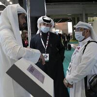 Visitors and exhibitors wear masks at the Arab Health Exhibition in Dubai, United Arab Emirates, January 29, 2020. (AP Photo/Kamran Jebreili)