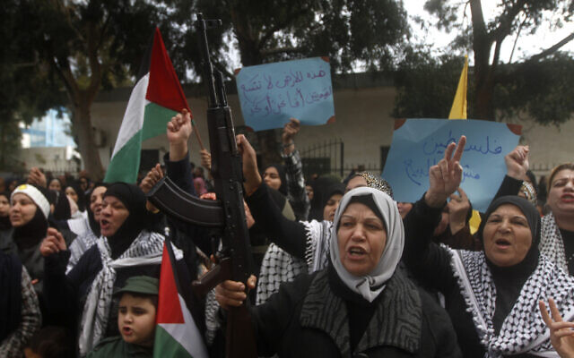 Palestinians protest against the White House plan for ending the Israeli-Palestinian conflict, at Rashidiyeh Palestinian refugee camp, southern Lebanon, on January 29, 2020.  (AP/Mohammed Zaatari)