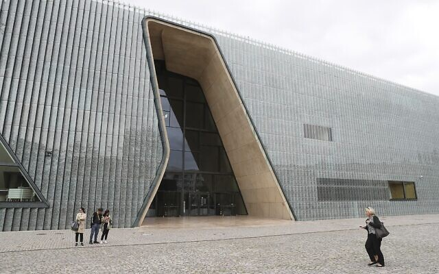 In this July 16, 2019 file photo people pass the Museum of the History of Polish Jews in Warsaw, Poland. (AP Photo/Czarek Sokolowski/file)
