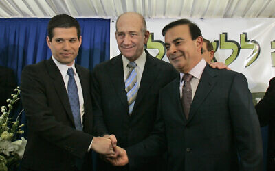 Then prime minister Ehud Olmert, center, shakes hands with Israeli investor Shai Agassi, left, and Carlos Ghosn at the Prime Minister's office in Jerusalem, January 21, 2008. (AP Photo/Sebastian Scheiner)
