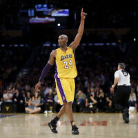 Los Angeles Lakers forward Kobe Bryant gestures during the first half of his last NBA basketball game, against the Utah Jazz, on April 13, 2016, in Los Angeles. (AP Photo/Jae C. Hong)