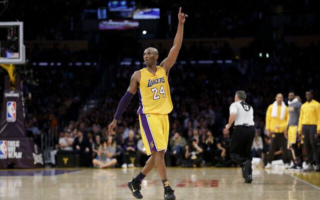 Los Angeles Lakers forward Kobe Bryant gestures during the first half of his last NBA basketball game, against the Utah Jazz, on April 13, 2016, in Los Angeles. (AP Photo/Jae C. Hong)