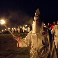 "Members of the Ku Klux Klan participate in cross burnings after a ""white pride"" rally in Georgia on April 23, 2016. (AP Photo/John Bazemore)"