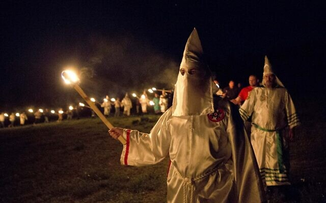 """Members of the Ku Klux Klan participate in cross burnings after a """"white pride"""" rally in Georgia on April 23, 2016. (AP Photo/John Bazemore)"""