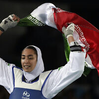 File: Kimia Alizadeh of Iran celebrates after winning the bronze medal in a women's Taekwondo 57-kg competition at the 2016 Summer Olympics in Rio de Janeiro, Brazil, Thursday, Aug. 18, 2016. (AP Photo/Andrew Medichini)