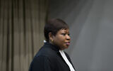 Public Prosecutor Fatou Bensouda enters the courtroom for the trial of Dominic Ongwen, a senior commander in the Lord's Resistance Army, whose fugitive leader Kony is one of the world's most-wanted war crimes suspects, at the International Court in The Hague, Netherlands, December 6, 2016. (AP Photo/Peter Dejong, Pool)