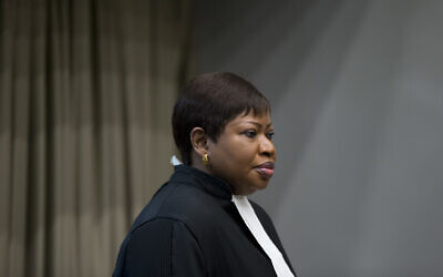 Public Prosecutor Fatou Bensouda enters the court room for the trial of Dominic Ongwen, a senior commander in the Lord's Resistance Army, whose fugitive leader Kony is one of the world's most-wanted war crimes suspects, at the International Court in The Hague, Netherlands, December 6, 2016. (AP Photo/Peter Dejong, Pool)
