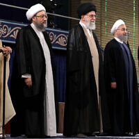 In this picture released by official website of the office of the Iranian supreme leader, Supreme Leader Ayatollah Ali Khamenei, center, President Hassan Rouhani, second right, parliament speaker Ali Larijani, right, judiciary chief Sadeq Larijani, second left, and head of the Assembly of Experts and secretary of Guardian Council Ahmad Jannati listen to the national anthem at the start of the official endorsement ceremony of President Rouhani in Tehran, Iran, August 3, 2017. (Office of the Iranian Supreme Leader via AP)