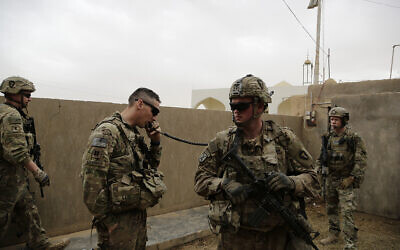 Illustrative: In this January 25, 2018 photo, American troops coordinate with Iraqi counterparts to launch airstrikes and artillery from a small complex in the town of Qaim, Iraq. (AP Photo/Susannah George)