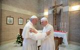 In this photo taken on June 28, 2017, Pope Francis (L) embraces Emeritus Pope Benedict XVI, at the Vatican. (L'Osservatore Romano/Pool Photo via AP)