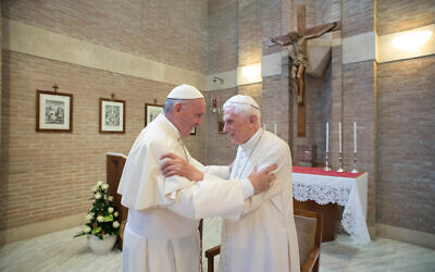 In this photo taken on June 28, 2017, Pope Francis (L) embraces Emeritus Pope Benedict XVI, at the Vatican. (L'Osservatore Romano/Pool Photo via AP)