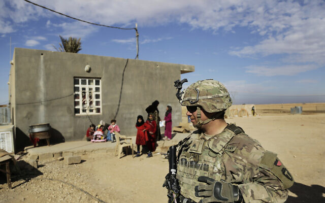 Illustrative: US Army soldiers speak to families in rural Anbar on a reconnaissance patrol near a coalition outpost in western Iraq, January 27, 2018. (Susannah George/AP)