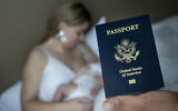 In this photo taken on Jan. 24, 2019, Denis Wolok, the father of 1-month-old Eva's father, shows the child's US passport during an interview with The Associated Press in Hollywood, Florida (AP Photo/Iuliia Stashevska)