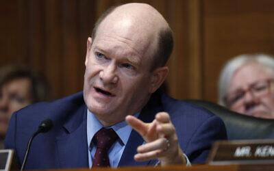 US Sen. Chris Coons questions Treasury Secretary Steve Mnuchin, May 15, 2019, on Capitol Hill in Washington. (AP Photo/Jacquelyn Martin)