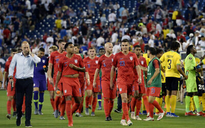 FILE -- United States National Team head coach Gregg Berhalter, left, walks off the pitch with players during a weather delay in the first half of a CONCACAF Gold Cup semifinal soccer match against Jamaica, July 3, 2019, in Nashville, Tenn. (AP Photo/Mark Zaleski)