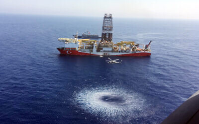 A helicopter flies over Turkey's drilling ship, 'Fatih' dispatched towards the eastern Mediterranean, near Cyprus, July 9, 2019. (Turkish Defence Ministry via AP, Pool)