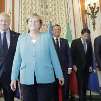 From the left, Britain's Prime Minister Boris Johnson, German Chancellor Angela Merkel, French President Emmanuel Macron, Italian Premier Giuseppe Conte and President of the European Council Donald Tusk pose during a G7 coordination meeting with the Group of Seven European members at the Hotel du Palais in Biarritz, southwestern France, Saturday, Aug.24, 2019. (AP Photo/Markus Schreiber, Pool)