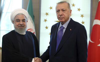 Turkish President Recep Tayyip Erdogan, right, greets Iran's President Hassan Rouhani before a meeting at the Cankaya Palace, in Ankara, Turkey, September 16, 2019. (Presidential Press Service via AP, Pool)
